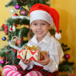 Small girls with presents — Stock Photo #39017691