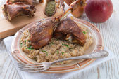 Roasted goose thighs with grits — Zdjęcie stockowe
