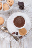 Hot chocolate with cookie — Stock Photo