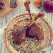 Stock Photo: Roasted goose thighs with grits