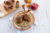 Roasted goose thighs with grits — Stock Photo