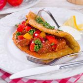 Hungarian goulash with potato pancake — Stock Photo