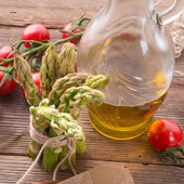 Asparagus, tomatoes  oil — Stock Photo