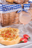 Onion tart and young wine — Stock Photo