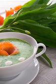 Garlic soup with smoked salmon — Stock Photo