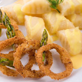 Onion rings with potato dumpling — Stock Photo