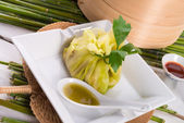 Cabbage with rice bags — Stock Photo