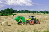 Tractors harvesting — Stock Photo