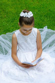 Girl reading First Holy Communion — Stock Photo