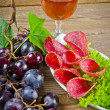 Pepper salami and bunches of grapes — Stock Photo #6819956