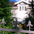 Mansion behind the iron fence in Jurmala - Stock Photo