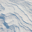 Texture of the snow cover on the beach on a sunny day — Stock Photo
