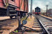 Old locomotive and cars on a railway station — Stock Photo