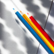 Colored pencils on colored paper with stripes — Stock Photo