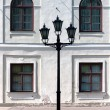 City lantern on the background wall of the palace. Riga — Foto de Stock