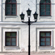 City lantern on the background wall of the palace. Riga — Photo