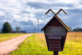 Old mailbox near the road — Stock Photo