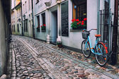 Bicycle on the old street in Riga — Stock Photo