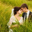Wedding couple kissing outdoors — Stock Photo