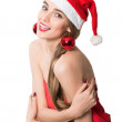 Happy christmas woman wearing a santa hat smiling isolated over a white background — Stock Photo #16504899