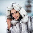Stock Photo: Beautiful smiling womin fur coat in park