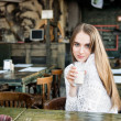 Beautiful happy woman drinking at the cafe — ストック写真