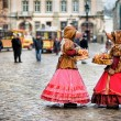 Two woman in traditional clothes standing in the square in old city Lvov - ストック写真