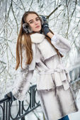 Woman in fur in the winter park — Stock Photo