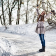 Beautiful woman walking in winter forest and have fun — Stock Photo #20040293
