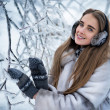 Happy beautiful woman in the winter forest — Stock Photo