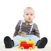 Adorable one year old child boy playing with a toy, studio isolated on white — Stock Photo