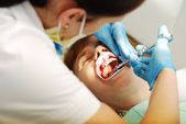 Work of doctors in the dental clinic — Stock Photo