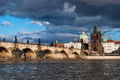 Charles bridge across the river in old town of Praha — Stock Photo