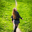 Beautiful woman walking on the footpath outdoorg — Stock Photo