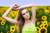 Beautiful happy woman with sunflowers outdoors — Stock Photo
