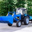 Blue tractor with trailer for cleaning park territories in the city — Stock Photo