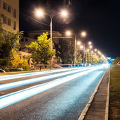 Aspalt road with illuminations in the city — Stock Photo