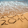 New Year 2014 is coming concept - inscription 2013 and 2014 on a beach sand — Stock Photo #33350435