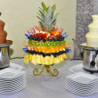 Chocolate fountains with fruits on the table — Stock Photo