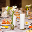 Table served with a meal in a restaurant with candles and flowers — Foto Stock
