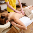 Picture of lyinng woman on massage table in salon  — Stock Photo