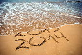 New Year 2014 is coming concept - inscription 2013 and 2014 on a beach sand — Stock Photo
