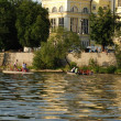 Tourists voyage on the Vltava river in Prague — Stock Photo