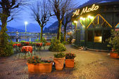 COMO, ITALY - NOVEMBER 16: Famous restaurant in Como near lake and mountains at the evening on November 16, 2013 in Como, Italy. — Stock Photo