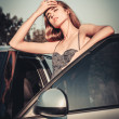 Beautiful woman tired after car driving — Stock Photo