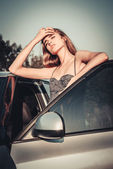 Beautiful woman tired after car driving — Stockfoto