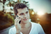 Man talking by the mobile phone outdoors — Stock Photo