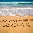 Inscription on wet sand Summer 2014. Concept of summer vacation — Stock Photo
