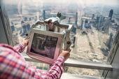 Digital binoculars in dubai skyscraper — Stock Photo