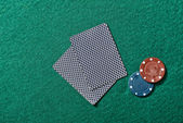 Poker chips on a poker table — Stock Photo